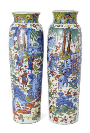 A pair of Chinese porcelain 'clobbered' sleeve vases, Transitional period, painted in underglaze