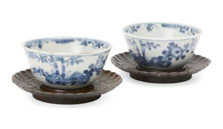 A pair of Chinese porcelain tea bowls, Kangxi period, painted in underglaze blue with bamboo and