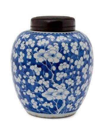 A Chinese porcelain ginger jar, Kangxi period, painted in underglaze blue with prunus blossom on a
