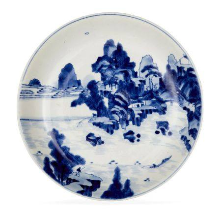 A Chinese porcelain dish, early 18th century, painted in underglaze blue with a scholar watching two