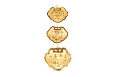 THREE CHINESE GOLD PENDANTS