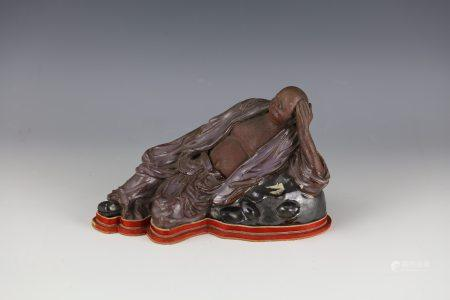 A Chinese SHIWAN STATUE OF LUOHAN with Wood Base