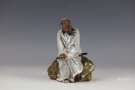 A Chinese Shiwan Statue Luohan Sitting on Rock