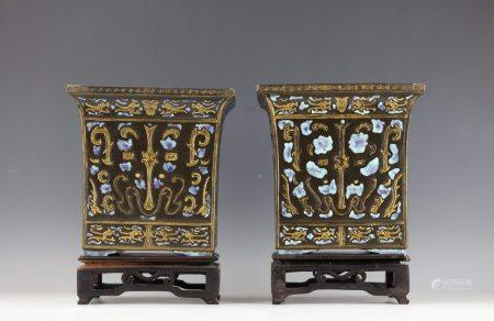 A Pair of Black Ground Gild Painted Ceramic Planter with Wood Base