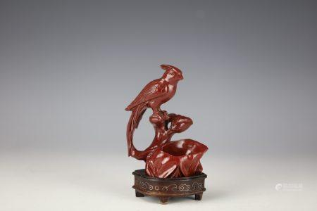 A Chinese Red Agate Carved Bird with Base