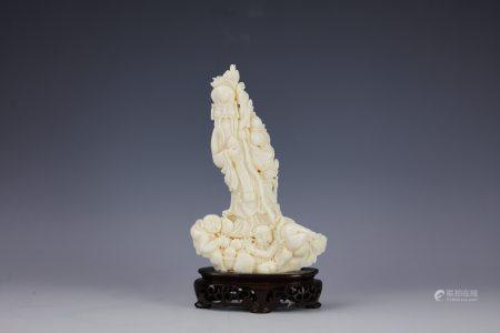 A Chinese White Coral Carved Longevity God with Base