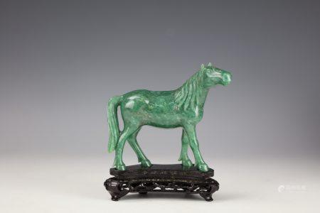 A Chinese Green Jade Carved Horse with Base