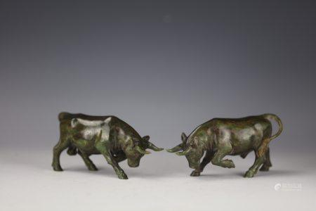 A Pair of Chinese Green Jade Carved Bull