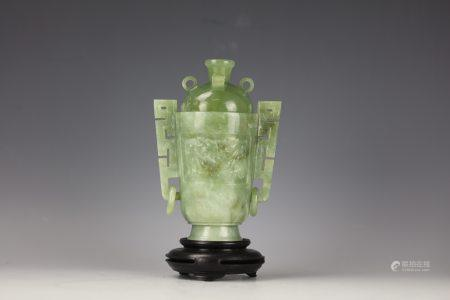 A Chinese Green Jade Carved Jar with Double Handle and
