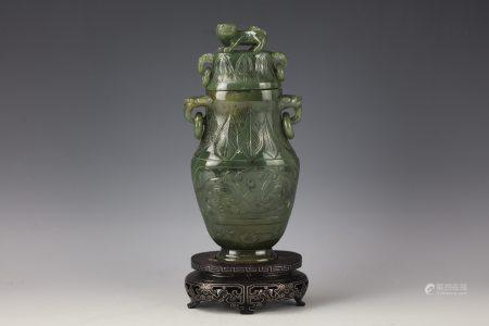 A Chinese Green Jade Carved Vase with Double Handle and