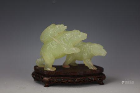 A Chinese Light Green Jade Carved Three Bears with Base