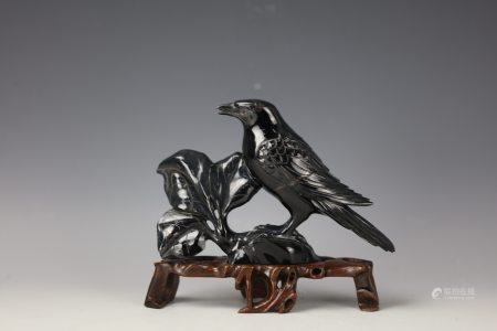 A Chinese Black Stone Carved Bird with Base
