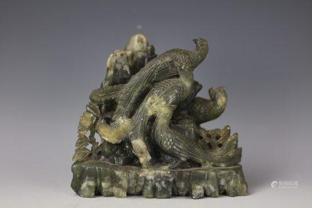 A Chinese Green Jade Carved Peacocks