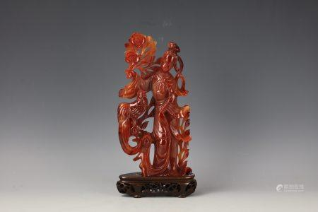 A Chinese Red Agate Carved Fairy with Base