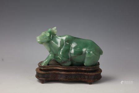 A Chinese Green Jade Carved Bull with Base