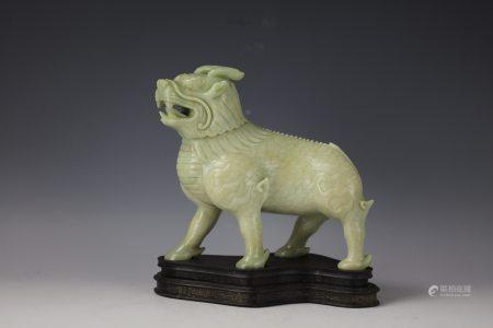 A Chinese Green Jade Carved Qinlin Foodog with Base