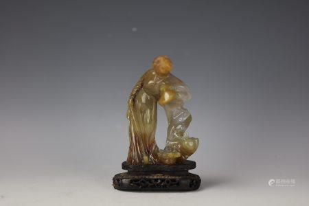 A Chinese Carved Agate Fairy with Base
