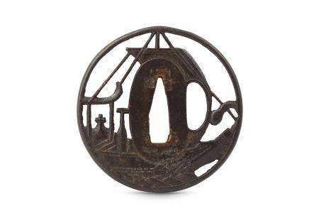 AN IRON SUKASHI NAMBAN TSUBA. Edo period. Of circular form, pierced in the form of a Portuguese ship
