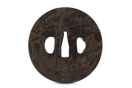 AN IRON NAMBAN TSUBA. Edo period. A circular plate carved on a hammer ground with a sailing