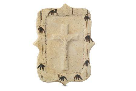 A POTTERY PLAQUE OF CRUCIFIXION. Edo period. A shaped glazed pottery plaque with a press mould