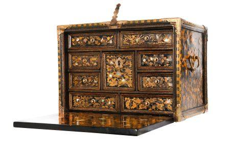 A NAMBAN CABINET. Late 16th Century. Of rectangular form, the hinge fall-front decorated with