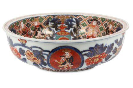 AN IMARI NAMBAN SHIP BOWL. Meiji period. The shallow bowl with a flat rim, painted in iron-red,