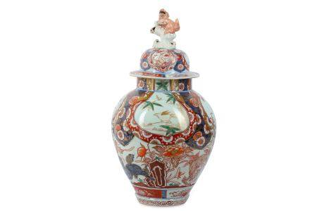 AN IMARI VASE AND COVER. 18th Century. The oviform body painted in iron red, green, and gilt with