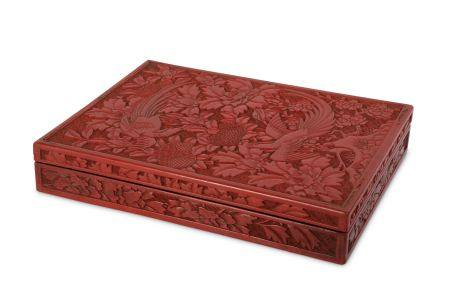 A CHINESE CINNABAR LACQUER RECTANGULAR 'PARADISE FLYCATCHERS' BOX AND COVER.