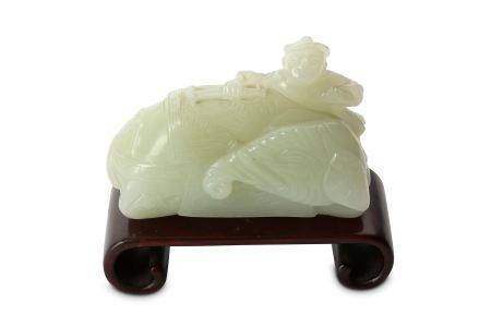 A CHINESE PALE CELADON JADE CARVING OF AN ELEPHANT AND A MAHOUT.