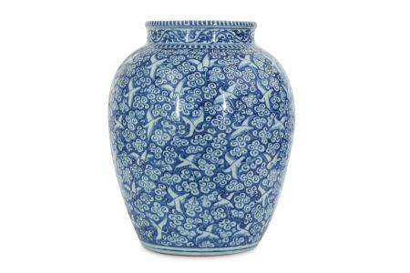 A CHINESE REVERSE BLUE AND WHITE 'HUNDRED CRANE' JAR.