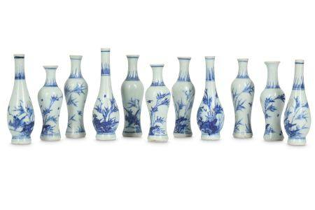 ELEVEN CHINESE BLUE AND WHITE MINIATURE VASES.