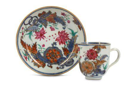 A CHINESE FAMILLE ROSE 'TOBACCO LEAF' COFFEE CUP AND SAUCER.
