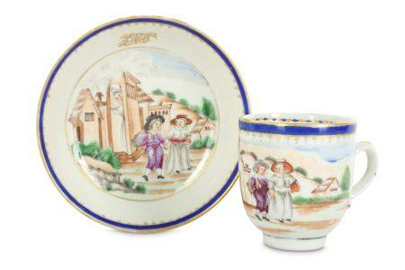 A CHINESE FAMILLE ROSE 'GOING TO SCHOOL' COFFEE CUP AND SAUCER.