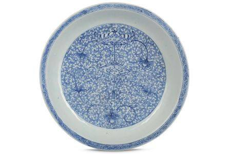A CHINESE BLUE AND WHITE 'BAT AND CHIME' DISH.