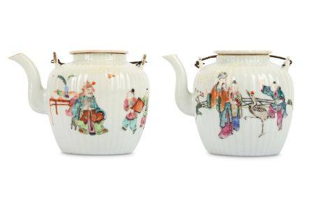TWO CHINESE FAMILLE ROSE TEAPOTS AND COVERS.
