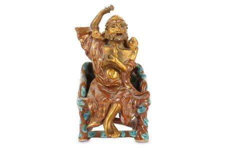 A CHINESE GILT-DECORATED ROBIN'S EGG-GLAZED FIGURE OF AN IMMORTAL.