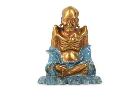 A CHINESE GILT-DECORATED ROBIN'S EGG-GLAZED FIGURE OF A LUOHAN.