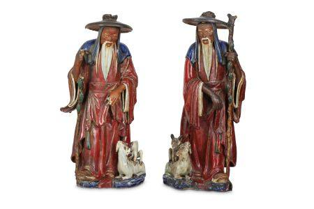 A PAIR OF CHINESE SHIWAN FIGURES OF IMMORTALS.