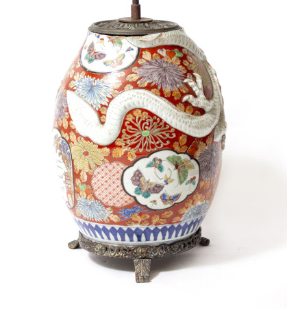 A TABLE LAMP constructed from a Chinese porcelain red ground ovoid vase, with entwined moulded