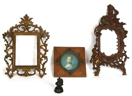 A Chinese bronze bird form opium weight; together with a gilt metal mirror and two photograph frames