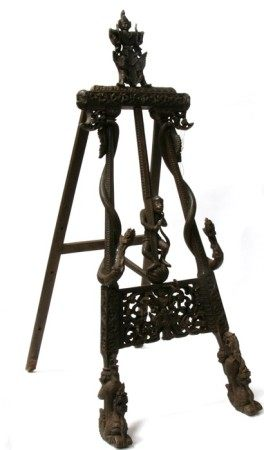 An impressive Burmese or Thai carved hardwood easel with central monkey figure flanked by