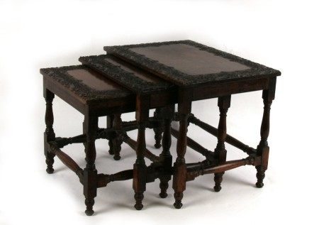 A nest of three Asian profusely carved hardwood tables, probably Burmese, the largest 41cms (