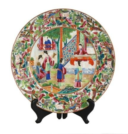 A 19th century Chinese famille rose Canton Export plate decorated with figures on a terrace within a