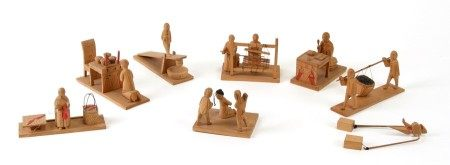 A group of Chinese carved wooden figures depicting scholars, peasants and torture. Largest 9cm (3.