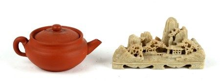 A Chinese yixing miniature tea pot. 5cm (2 ins) high together with a soapstone carving depicting a