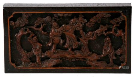 A pierced and carved Chinese hardwood plaque depicting dancing figures, 17cms (6.75ins) wide.