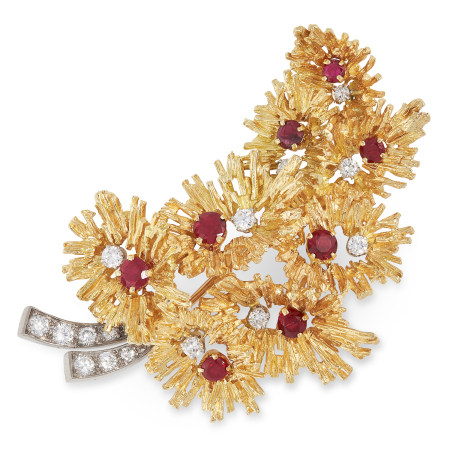 A VINTAGE RUBY AND DIAMOND BROOCH, ANDREW GRIMA 1968 designed as a naturalistic foliate spray set
