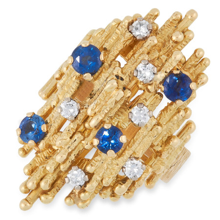 A SAPPHIRE AND DIAMOND RING, ANDREW GRIMA 1972 the naturalistic, bark textured face jewelled with