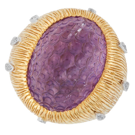 AN AMETHYST AND DIAMOND RING, ANDREW GRIMA 1968 set with a carved amethyst featuring concave berry