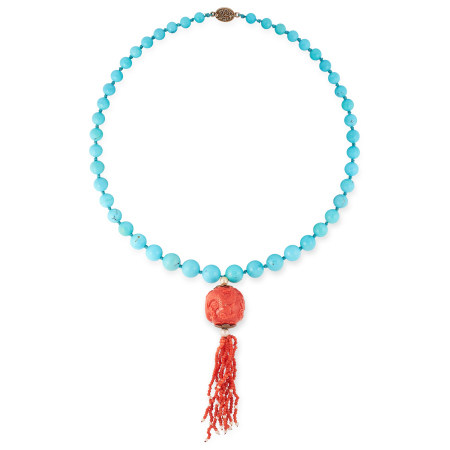 A CHINESE CARVED CORAL AND TURQUOISE NECKLACE comprising a single row of forty-six graduated round